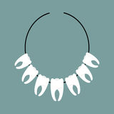 Necklace of teeth. Decoration on neck of  Indians. Mascot for Ab Royalty Free Stock Photos