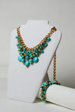 Necklace with turquoise, natural gemstones and gold chain on a mannequin Royalty Free Stock Images