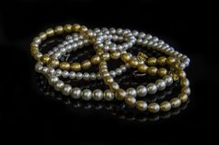 Necklace of white and yellow pearls Royalty Free Stock Photos