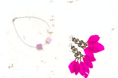 Necklace for women earrings with feathers pink white background Stock Images