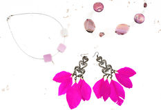 Necklace for women earrings with feathers pink white background royalty free stock image
