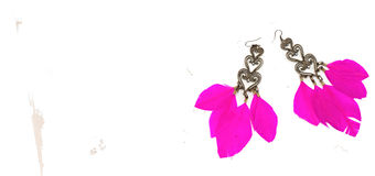 Necklace for women earrings with feathers pink white background Stock Photo