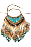 Necklace of wooden beads with feathers Stock Photos