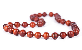 Necklace with wooden beads isolated on white Stock Images