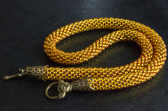 Necklace from yellow beads against a dark background Royalty Free Stock Photography