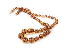 Necklaces. Brown amber necklet in detail Royalty Free Stock Images