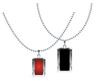 Necklaces. Two silver necklaces with red and black pendents Stock Image