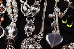Necklaces and accessories on black background Royalty Free Stock Photo