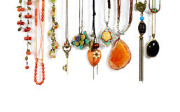 Necklaces. So beautiful necklaces hang on the wall Stock Image
