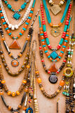 Necklaces on display. Handmade necklaces for sale on a brown board Stock Images