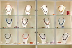 Necklaces on display in jewelry Stock Photo