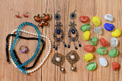 Necklaces, earrings and colored glass Stock Photo