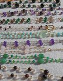 Necklaces in gold and gemstones for sale at flea market Royalty Free Stock Photography