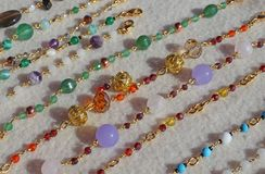 Necklaces in gold and gemstones for sale at flea market Stock Photos