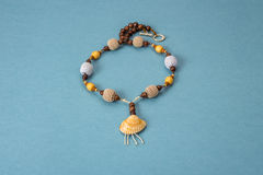 Necklaces handmade knitted and wooden beads with sea shells Royalty Free Stock Photos