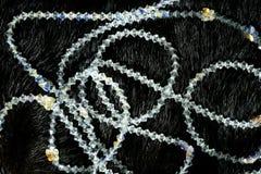 Necklaces over black animal skin background Stock Image
