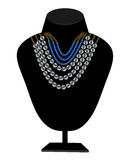 Necklaces of pearls and blue stones Royalty Free Stock Images