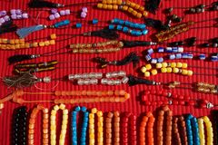 Necklaces of plastic beads on red cloth Royalty Free Stock Image