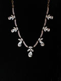 Necklaces with precious stones on a black background. Jewelery Royalty Free Stock Photography