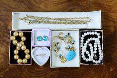 Necklaces, rings, earrings, pearls and gold in boxes Stock Photos