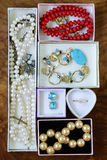 Necklaces, rings, earrings, pearls and gold in boxes Royalty Free Stock Photos