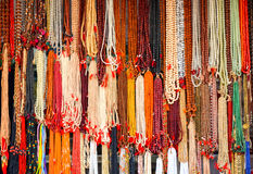 Necklaces for sale on a market stall, Rajasthan, India. Colourful beaded necklaces in a souvenir shop of Pushkar, India Stock Photography