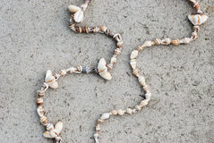 Necklaces of seashells on a gray background Royalty Free Stock Photo