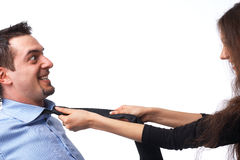 Necktie. Young couple arguing and struggling, holding the necktie over white Stock Image