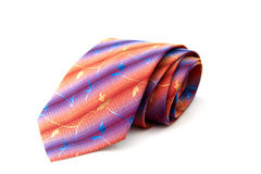 Necktie. A necktie rolled up against white background royalty free stock photos
