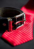 Necktie and belt. Red necktie and leather belt Royalty Free Stock Photo