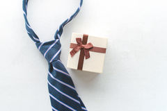 Necktie with gift view from above Happy Father's Day inscription. Background concept Stock Photo