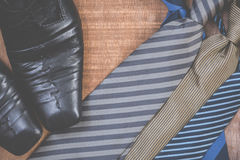 Necktie and shoes on grunge wood background Stock Images