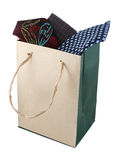 Necktie in shopping bag. Necktie in a shopping bag made from brown recycled paper stock photos