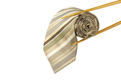 Necktie sushi. Male necktie roll as sushi with chopsticks isolated on white background stock images
