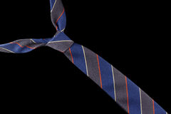 Necktie in wool with red, yellow and blue stripes Royalty Free Stock Photos