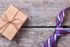 Necktie and wrapped present. Stock Images