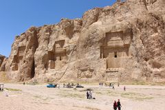 The necropolis of the Achaemenid dynasty, with large tombs cut high into the cliff face. Naqsh-e Rustam, Iran. The necropolis of the Achaemenid dynasty, with royalty free stock photography