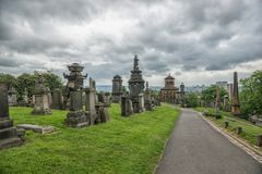 Necropolis, Glasgow, Scotland, UK, cemetery. Necropolis, Glasgow, Scotland, UK, tourism monument and atractions, cemetery, historic garden, summer and rainy Stock Photo