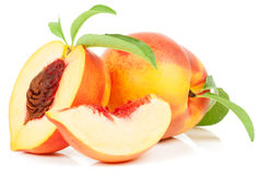 Nectarine. Red and yellow whole, half and slice with green leaves over white background royalty free stock photography