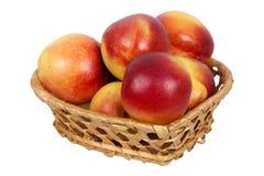 Nectarine in basket Stock Photos