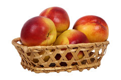 Nectarine in basket Stock Images