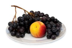 Nectarine and bunch of grapes Royalty Free Stock Image
