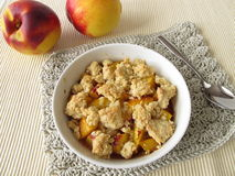 Nectarine crumble. And fresh fruits stock photography