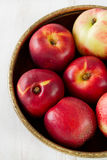 Nectarine in dish on table Stock Photo