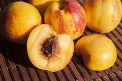 Nectarine. Fresh delicious nectarines, on a brown tablet Royalty Free Stock Photo