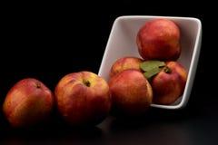 Nectarine friut on dark isolated background. With reflection stock photos