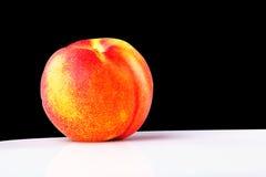 The Nectarine fruit. On the black background Royalty Free Stock Image
