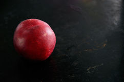 Nectarine fruit on a dark background on the left closeup Royalty Free Stock Photography