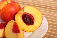 Nectarine fruit on plate Royalty Free Stock Photo