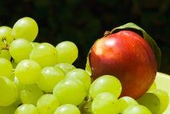 Nectarine and grape Stock Photography